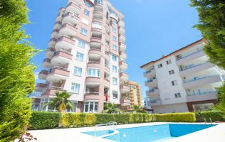 Sale of an apartment with two bedrooms in a residential complex with a swimming pool. Alanya, Mahmutlar