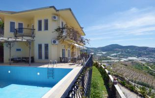 A separate two-storeyed villa with a private pool and great panorama of the sea in Alanya, Kargycak