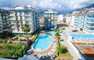 Two-bedroom apartment in a lovely modern residence right on the seaside in Kestel/Alanya