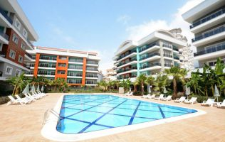 A luxurious three-bedroom apartment in a new residence in Alanya/Oba