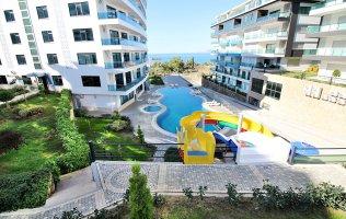 Новая трехкомнатная квартира с видом на море в Аланье, район Каргыджак