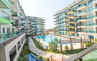 For sale 2+1 duplex apartment with sea and swimming pool view in Kargicak Alanya.