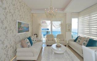 Двухуровневые меблированные апартаменты 2+1 с потрясающим видом на море, Кестель
