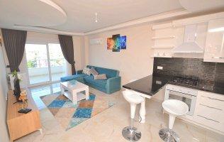 Уютная меблированная квартира 1+1 в современном комплексе в Алании, Кестель