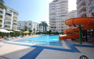 Furnished 2 + 1 at an attractive price on the Mediterranean coast in Mahmutlar, Alanya