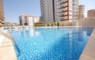 A modern complex in the green area of Mahmutlar, inexpensive real estate in Alanya
